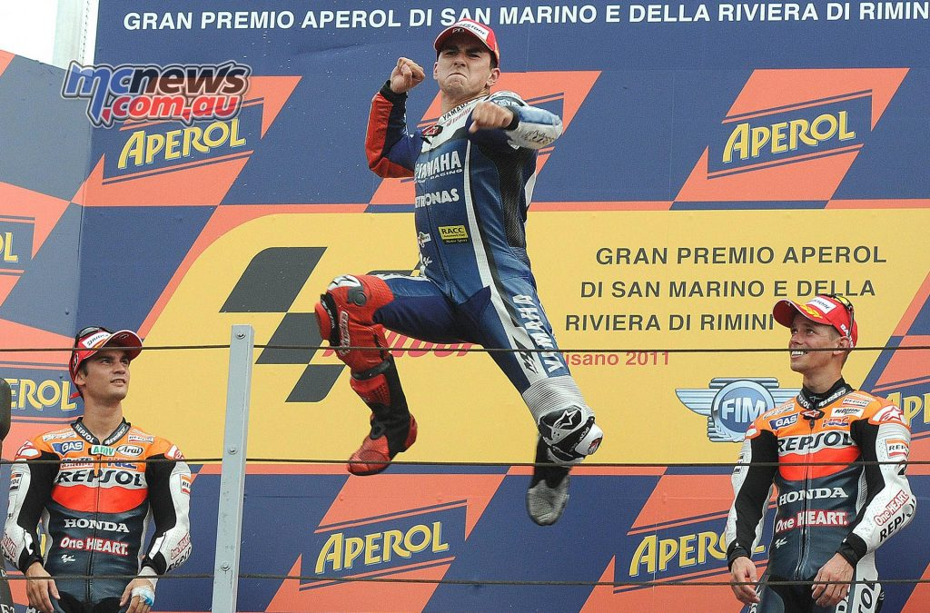 Jorge Lorenzo punches the air after taking victory at Misano in 2011