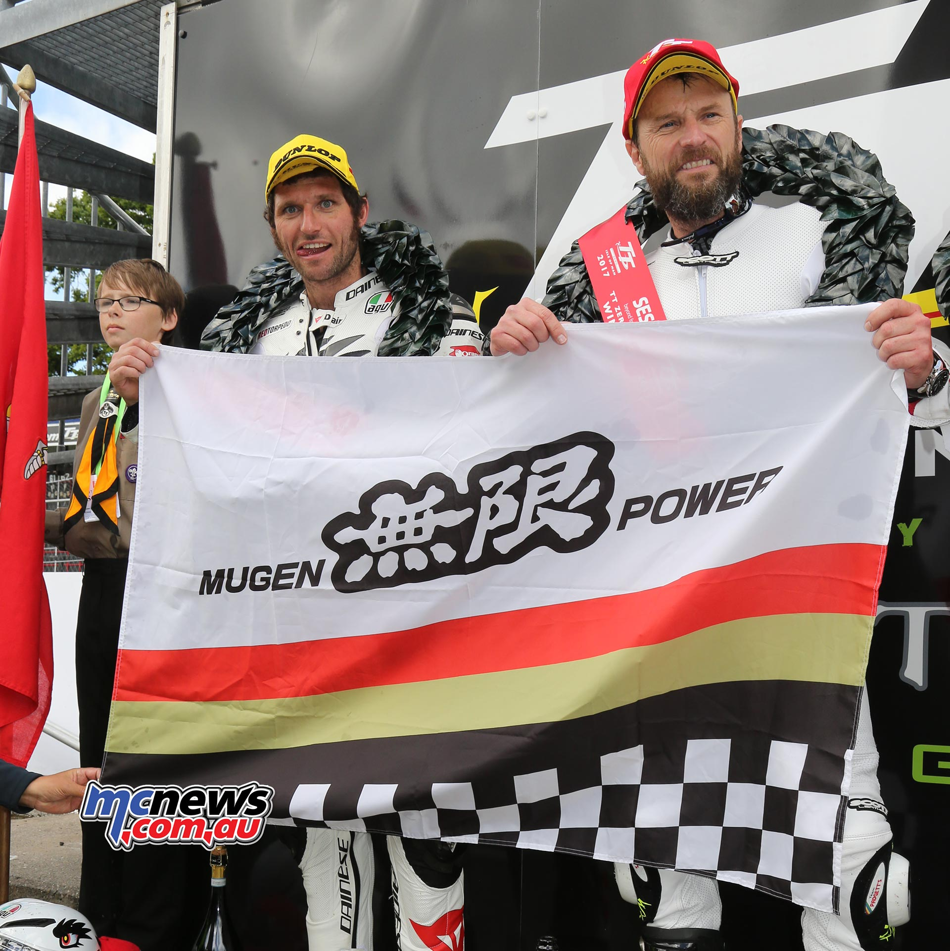 Bruce Anstey and Guy Martin flying the Mugden flag after their victory
