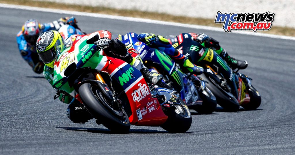 Aleix Espargaro leads Rossi and Zarco early in the race