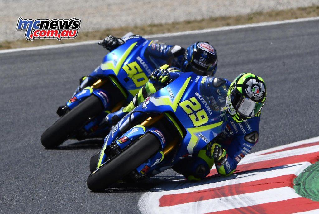 Andrea Iannone leads Sylvain Guintoli