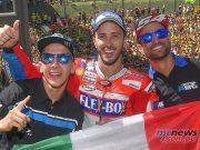 Triple Italian victory - Andrea Migno (Moto3), Andrea Dovizioso (MotoGP), and Mattia Pasini (Moto2)