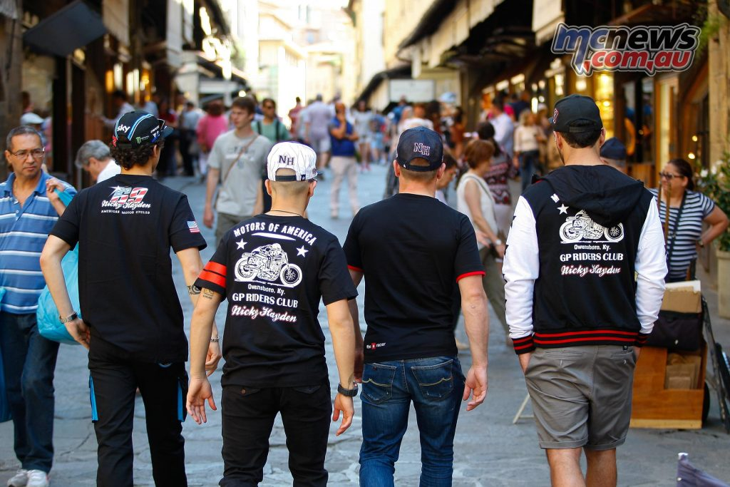 MotoGP riders taking a stroll in the busy streets of Florence