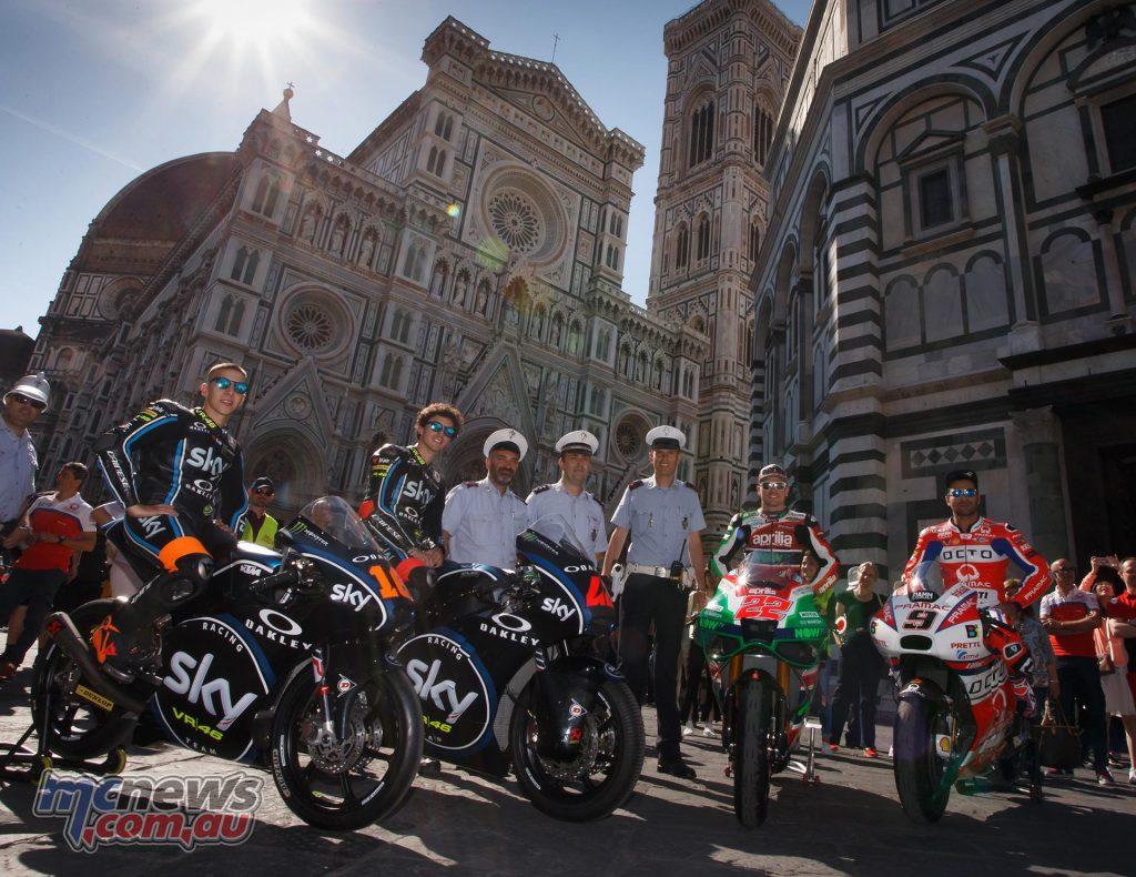 (L-R) Andrea Migno, Francesco Bagnaia, Sam Lowes, and Danilo Petrucci in front of Firenze's spectacular Duomo