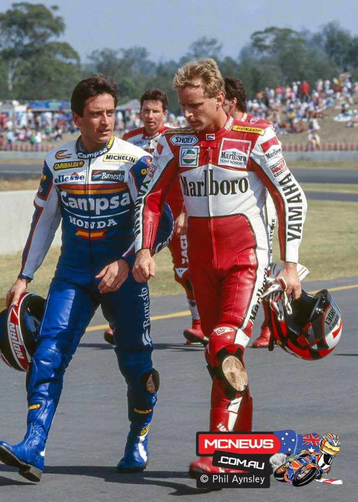 Sito Pons and Wayne Rainey chatting, Eddie Lawson in the background