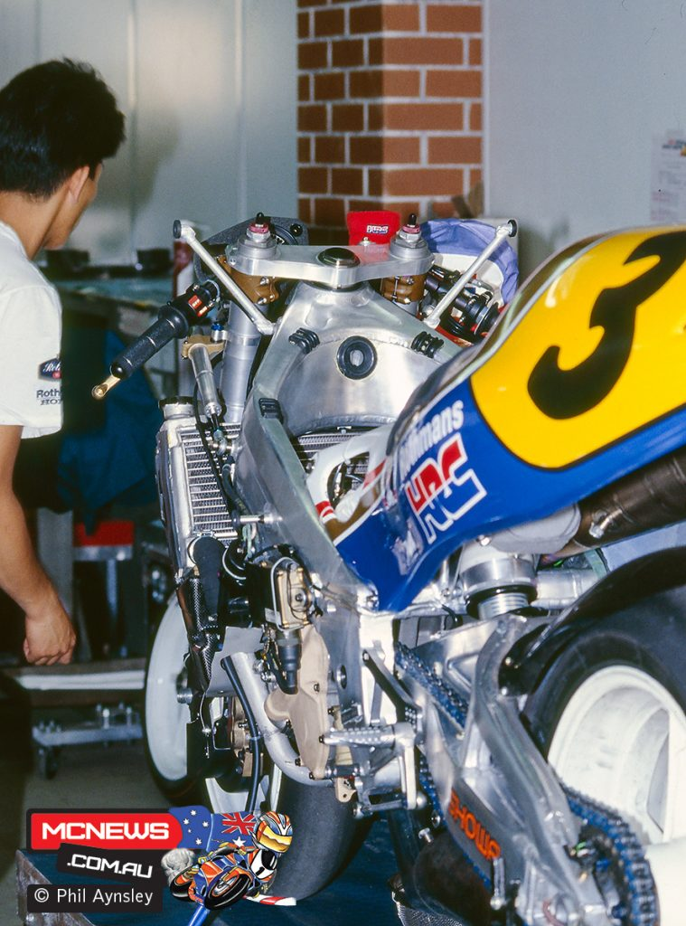 Mick's Honda NSR500 undergoing work in the pits