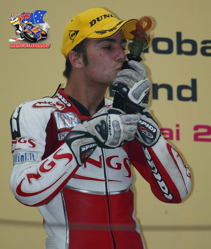 Mattia Pasini pictured here after his first Grand Prix win, which came in the 125cc category on China, 2005. Image by AJRN
