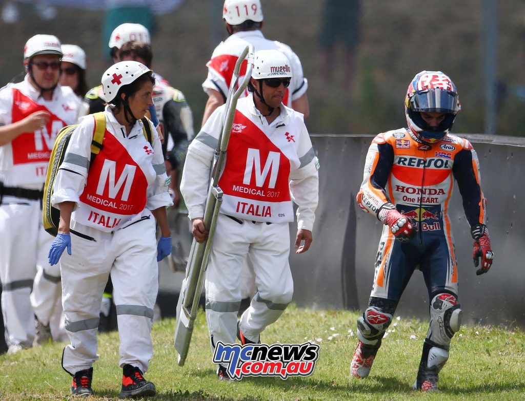 Dani Pedrosa walks away disgusted after taking out Cal Crutchlow - Image by AJRN