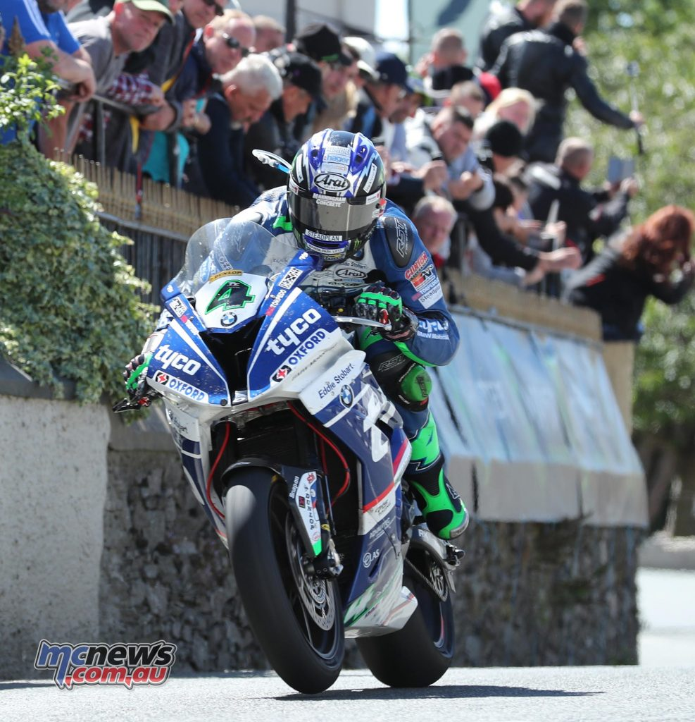 Ian Hutchinson passed the Raven Hotel at Ballaugh