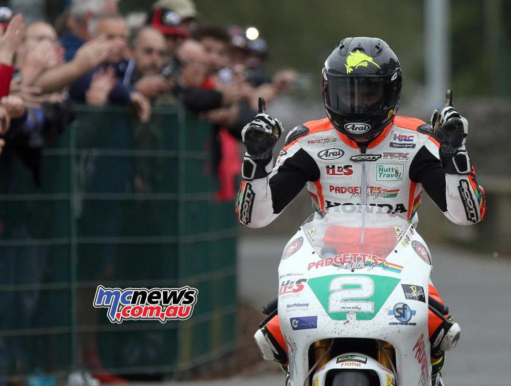 Bruce Anstey celebrates his win, and his new 250 TT Course lap record, at the end of the Dunlop Lightweight Classic TT Race. Photo Stephen Davison / Pacemaker Press Intl