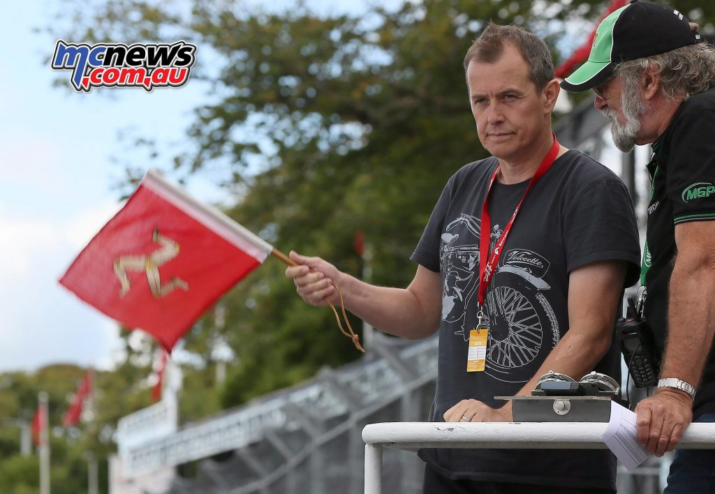 John McGuinness waves the Manx flag to start the Bennetts Senior Classic TT Race. Photo Stephen Davison / Pacemaker Press Intl.
