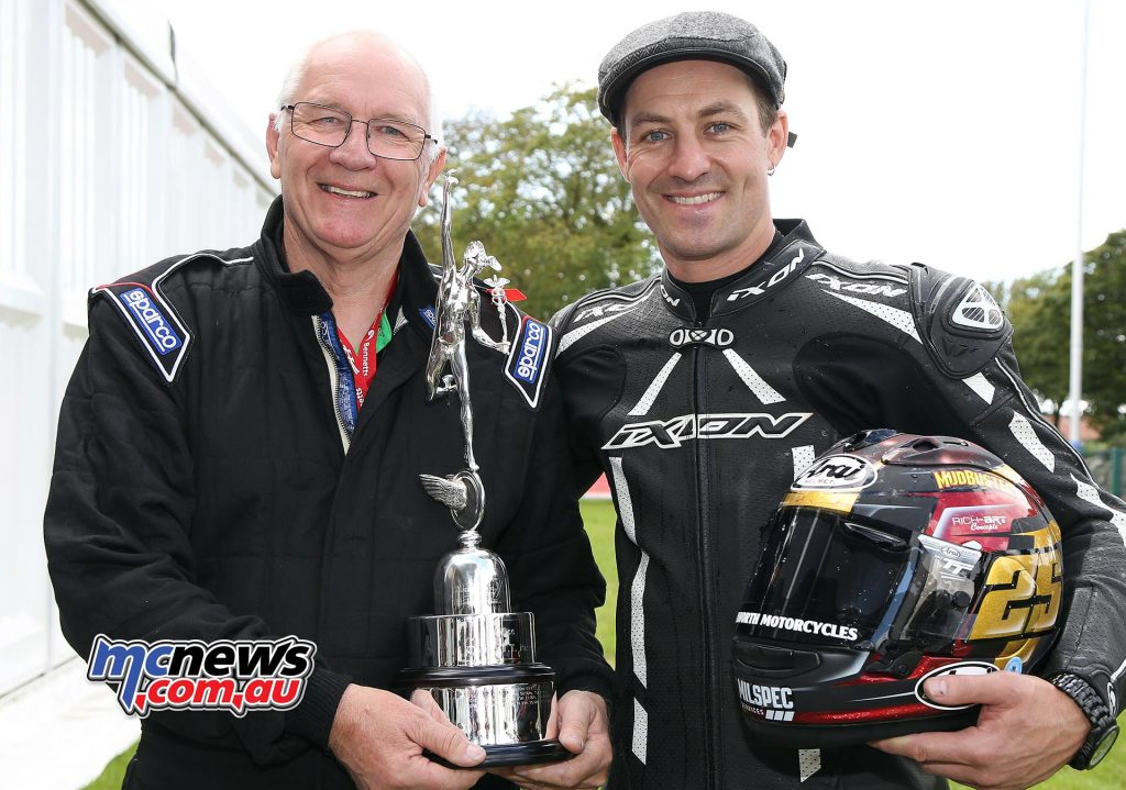 Josh Brookes with team owner Roger Winfield and the Mike Hailwood trophy. Photo Stephen Davison / Pacemaker Press Intl