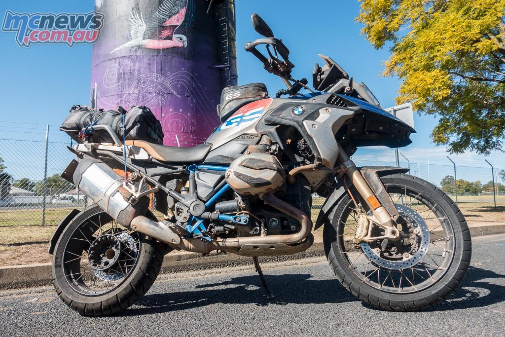 The R 1200 GS Rallye X poses for a photo in Coonamble. The mural is by Lightning Ridge artist John Murray, Bob Barrett and local Coonamble resident and Aboriginal painter Sooty Welsh.