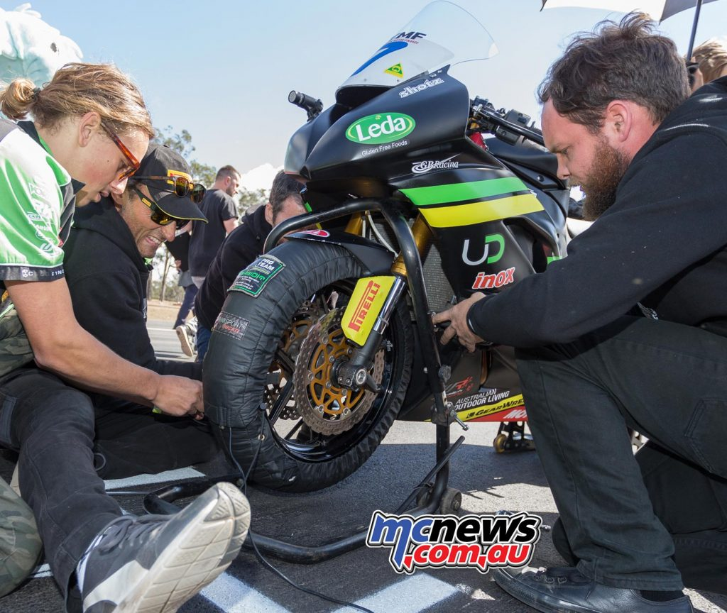 Cube Racing were very busy on the grid working on the front end of the Tom Toparis ZX-6R - Image by TBG