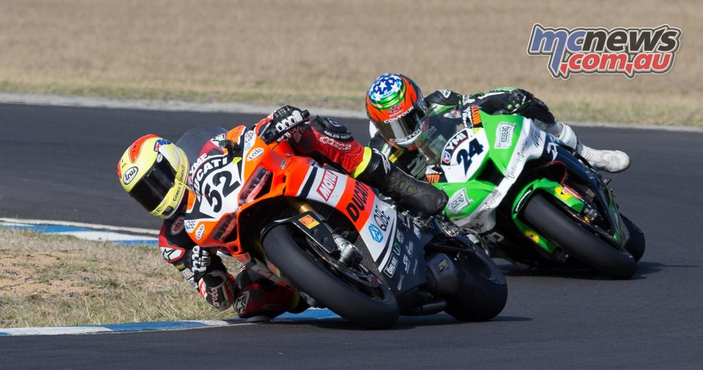 Corey Turner battling with five-time NZ Superbike Champion Robbie Bugden at Morgan Park - Image by TBGq