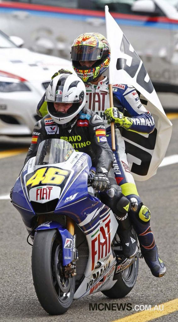 Angel Nieto gives Valentino Rossi a pillion ride in 2008 - Image by AJRN