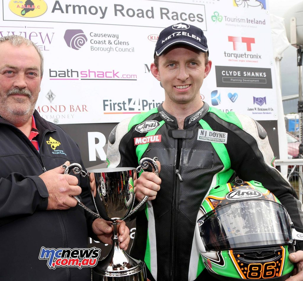 Derek McGee receives Man of the Meeting Trophy from Paul McAuley PMA Contracts