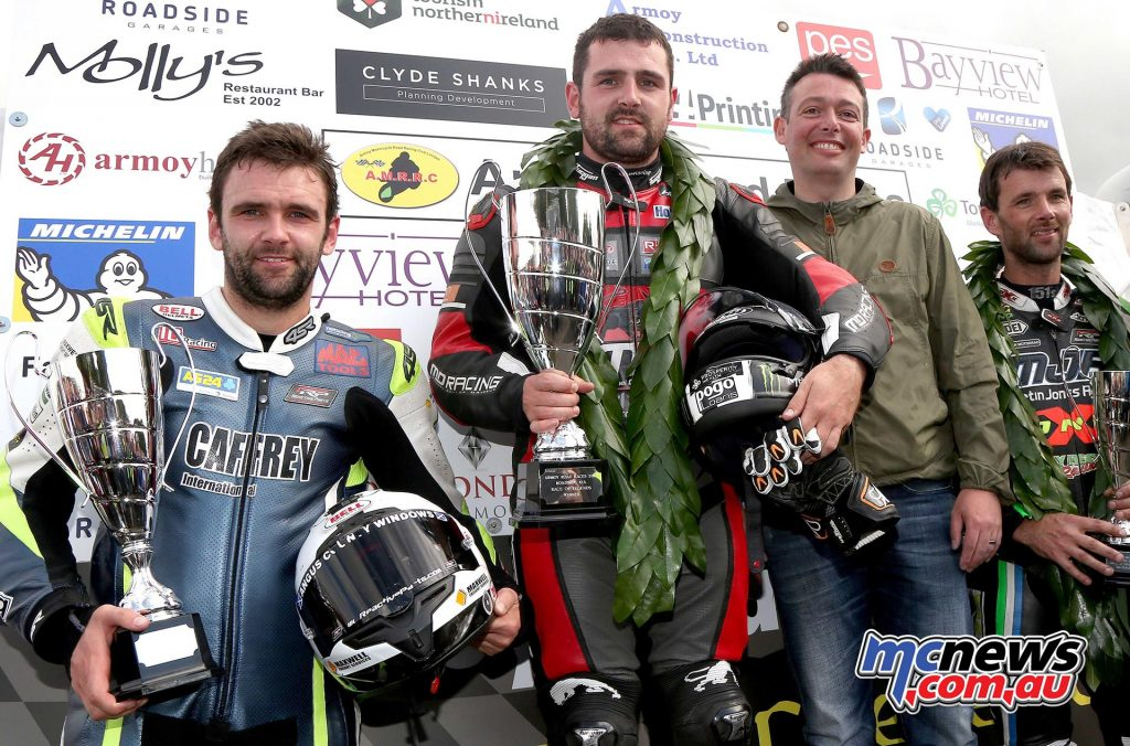Mark Lamont's Roadside Kia presents the trophies to winner Michael Dunlop, second William Dunlop and third Michael Sweeney with Miss Armoy Emma McGarrity.