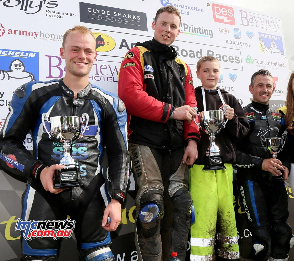Michelin Senior Support Race Joe Loughlin (1st) Adam Lyon (2nd) David Howard (3rd) with Miss Armoy Emma McGarrity and sponsor Duncan Livingstone from Michelin Tyre PLC