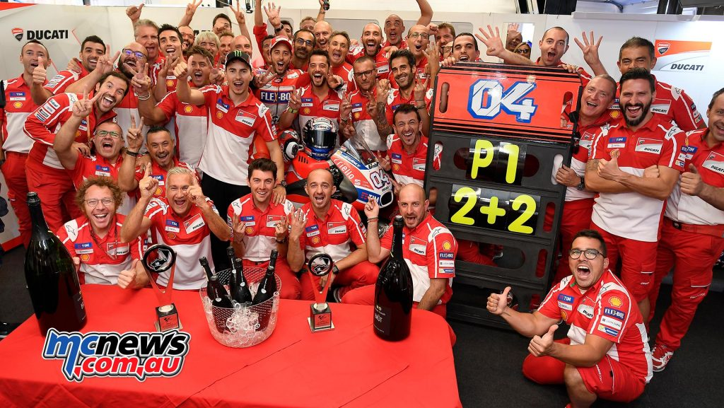 Andrea Dovizioso celebrates with the Ducati Team