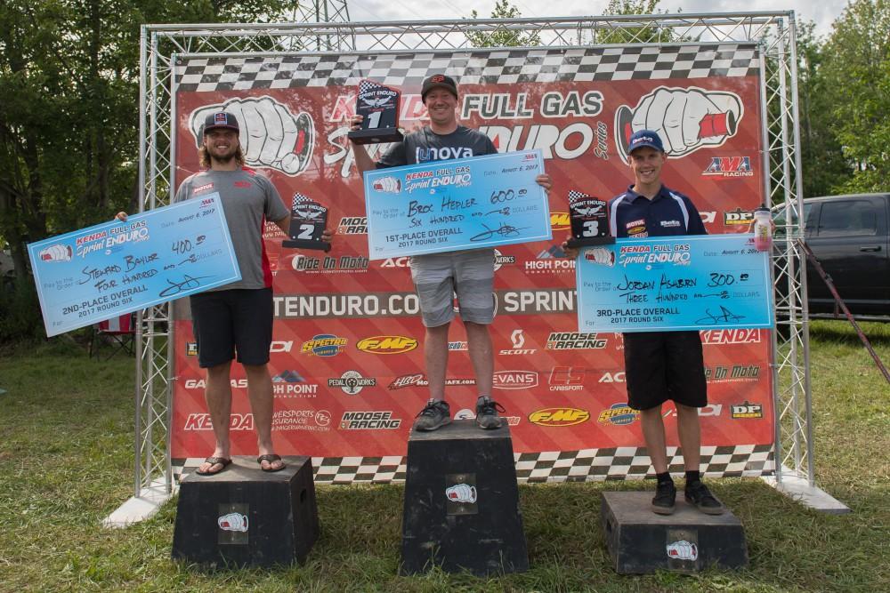 Steward Baylor, Broc Hepler and Jordan Ashburn celebrate Fairmount podium