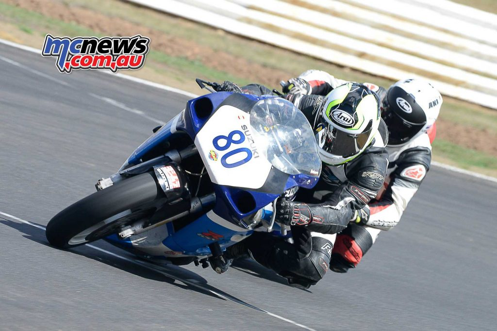 Drew Roberts Suzuki GSX-R600 leads Harry Seller on his Yamaha R6 onto the Front Straight