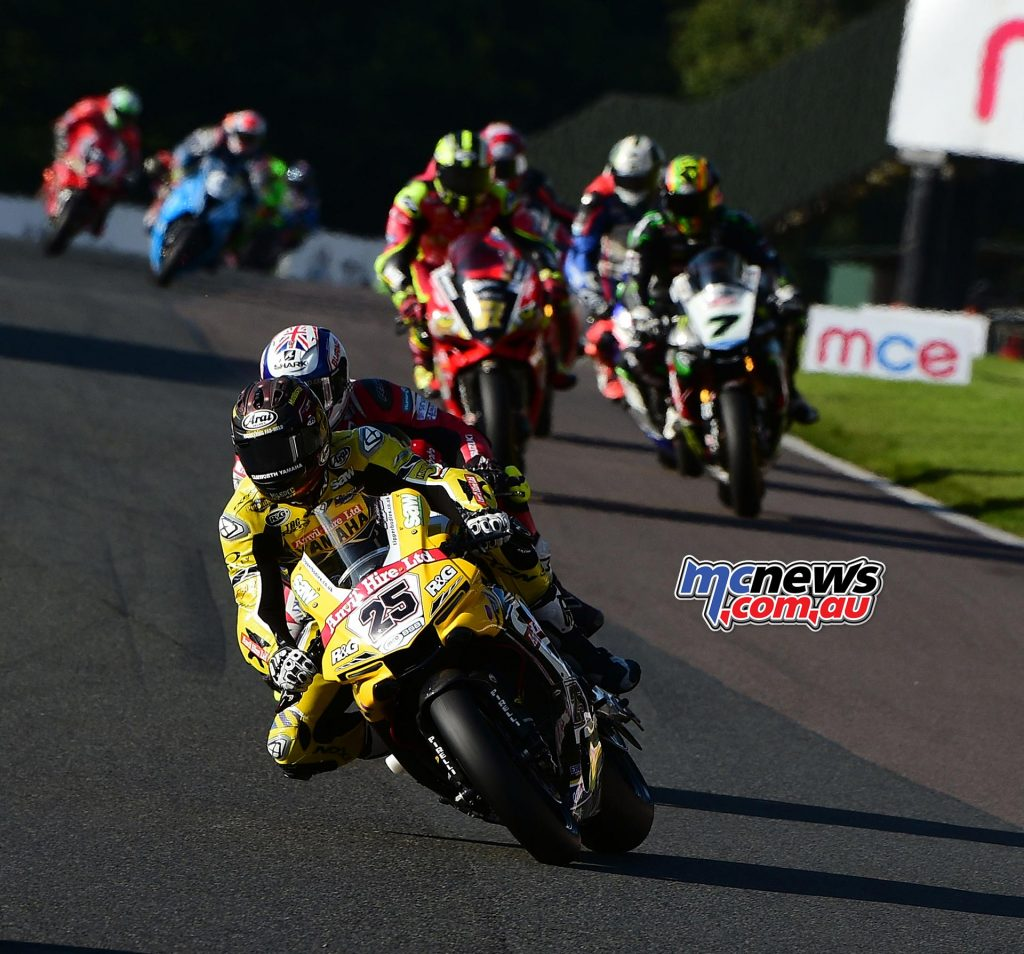 Dan Linfoot tight in behind Josh Brookes