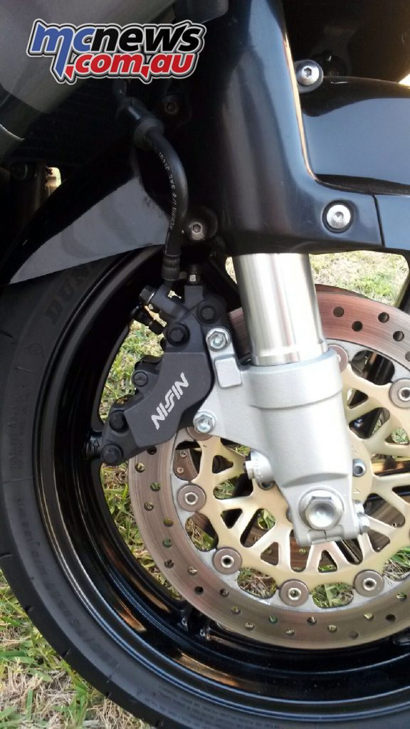 The bike still has the factory paint markings on the caliper bolts!
