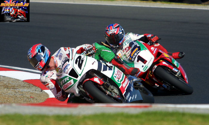 Colin Edwards leads Troy Bayliss at Phillip Island in 2002