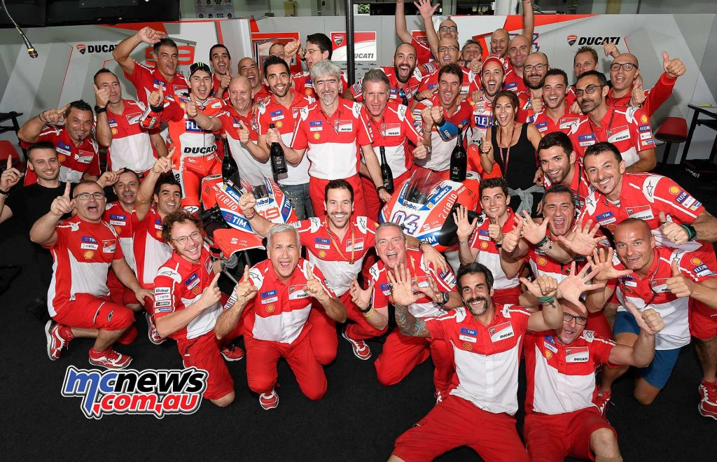 Andrea Dovizioso hunted down teammate Jorge Lorenzo to take a brilliant victory at Sepang and a 1-2 for Ducati