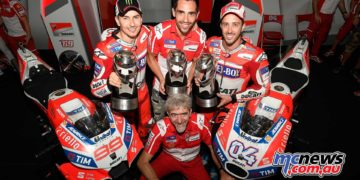 Andrea Dovizioso hunts down teammate Jorge Lorenzo to take a brilliant victory at Sepang and a 1-2 for Ducati