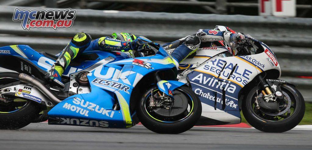Loris Baz battling with Andrea Iannone - Sepang MotoGP 2017