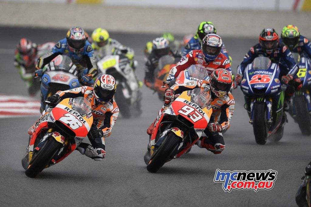Dani Pedrosa and Marc Marquez early in the race at Sepang