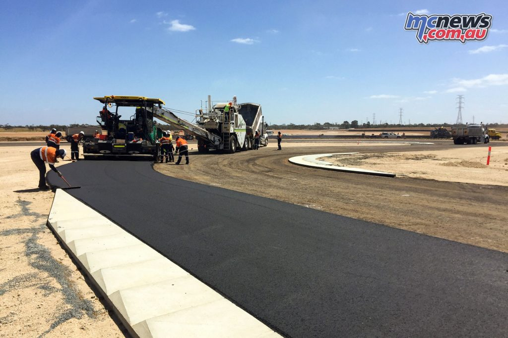 The leveling course is currently being laid by a single team, with a third the width of the track laid at a time