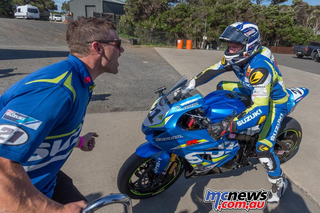 Josh Waters congratuled by brother Brodie as he returns to pitlane - Image by TBG
