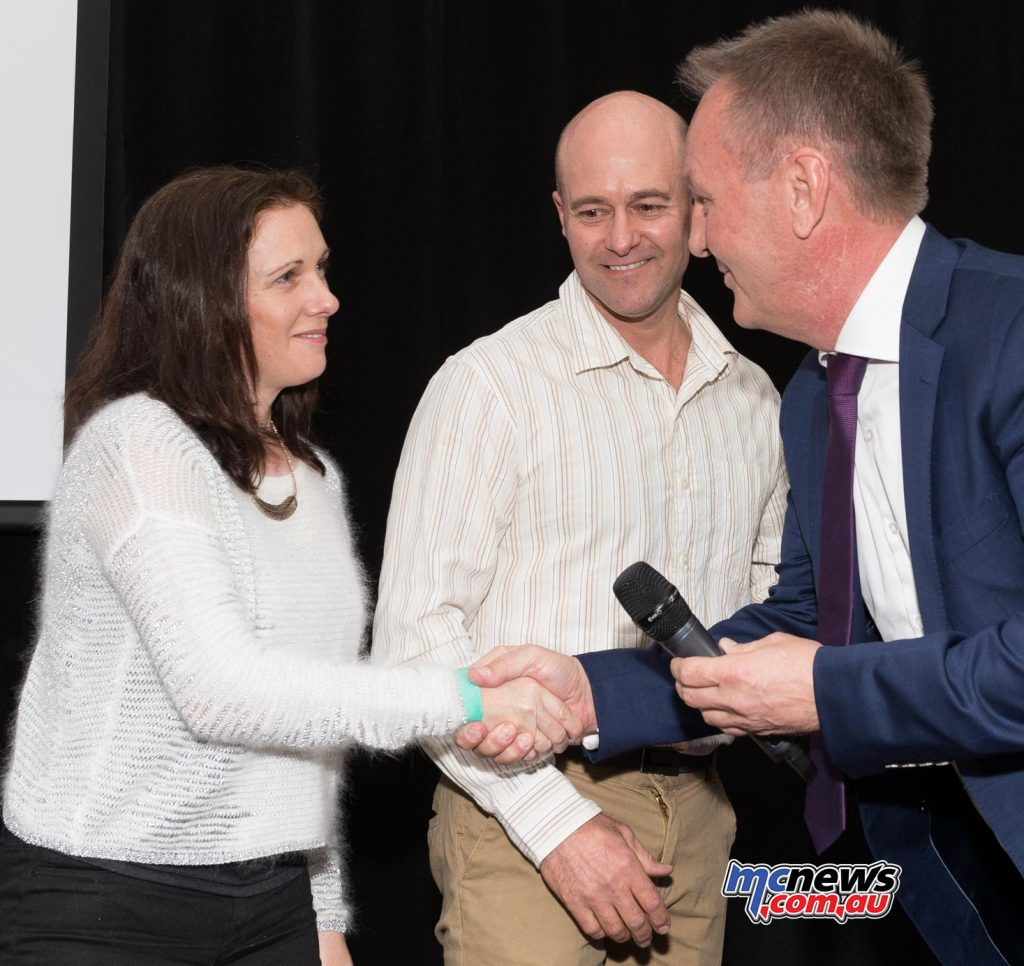 Peter Doyle at the dinner recognised the long participation in the series of Motologic / Team Honda Racing by welcoming Paul and Laura Free on to the stage - Image by TBG