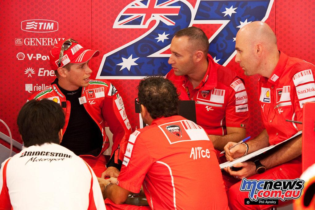 Casey Stoner in the Ducati pit box.