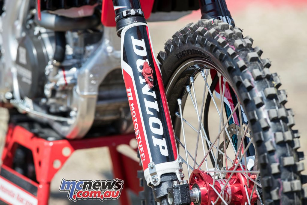 Both bikes run Showa forks