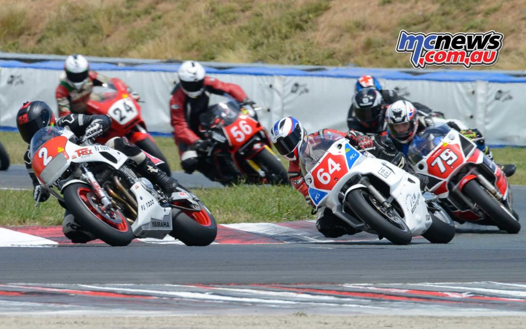 Chas Hern on the T Rex FJ1200 Yamah leads eventual championship winner Aaron Morris also on a FJ1200 and Stephen Kairl off the front straight in the Period 6 Unlimited field