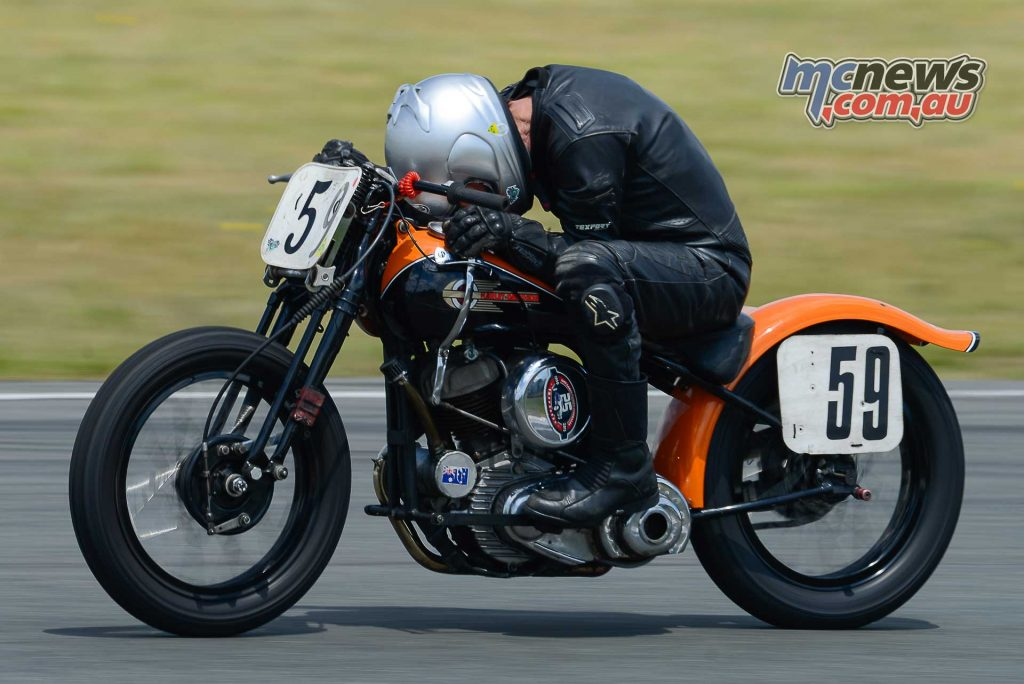 Malcolm Brice hard at the office on his 1942 Harley WLA hand shifter