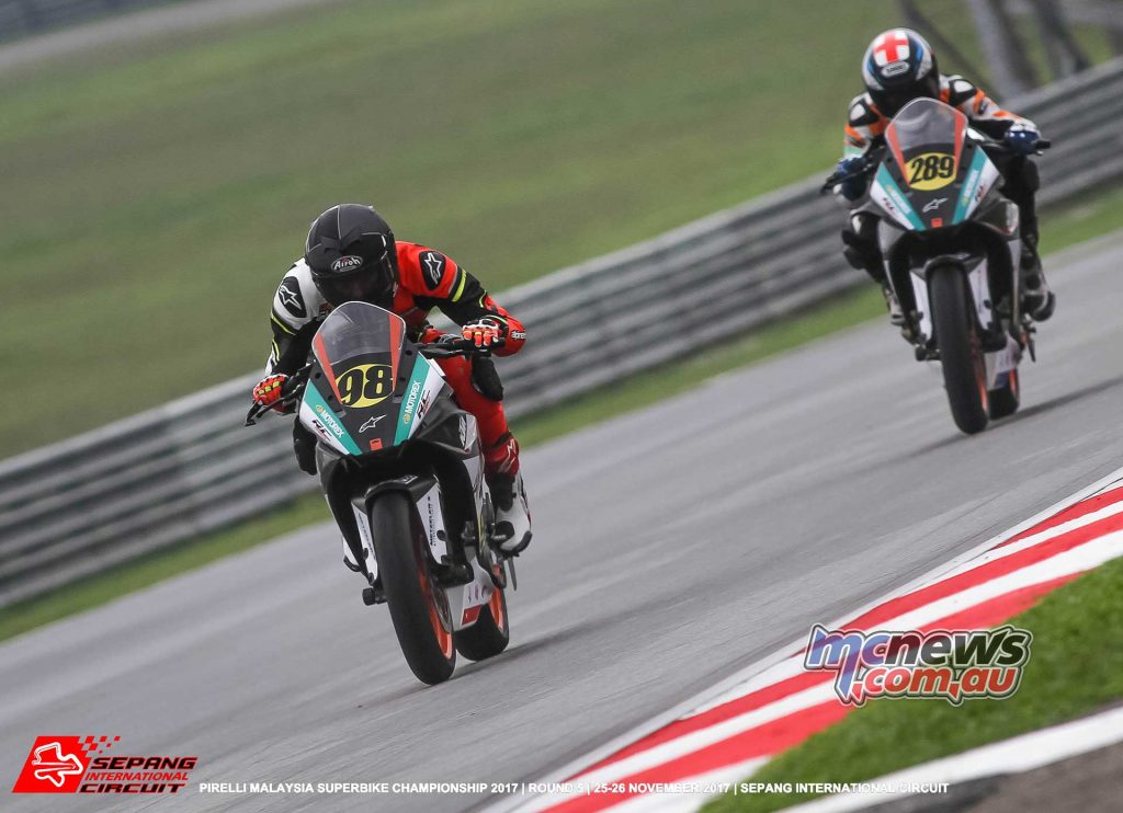 China's Zhou Shengjunjie leads Billy Van Eerde but the young Australian got the better of him before the chequered flag