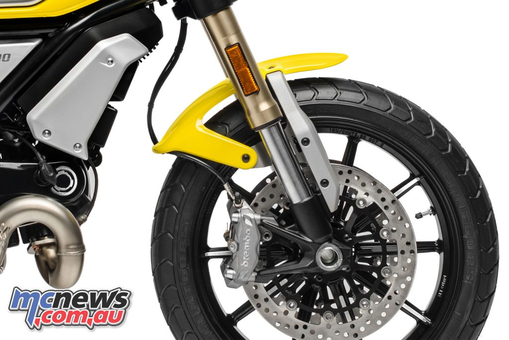 The front mudguard is held in place by aluminium supports