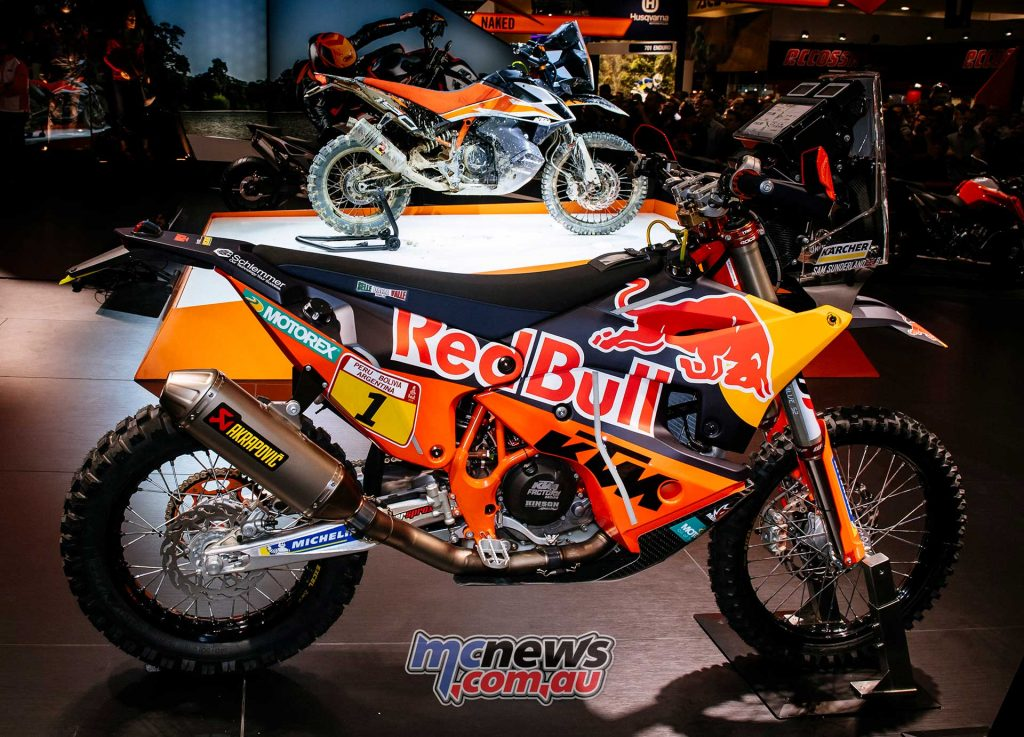 KTM 790 Adventure R prototype sits behind the full-monty KTM 450 Rally race machine in this shot from EICMA