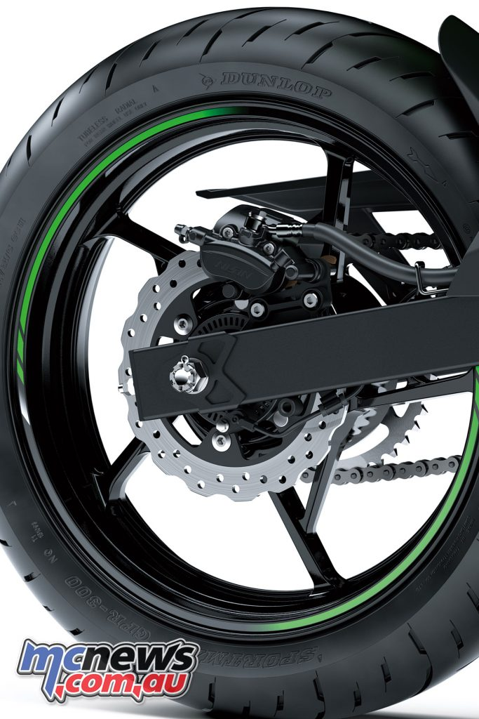 The front brake is a 310mm with two-piston caliper, while the rear is a 220mm item