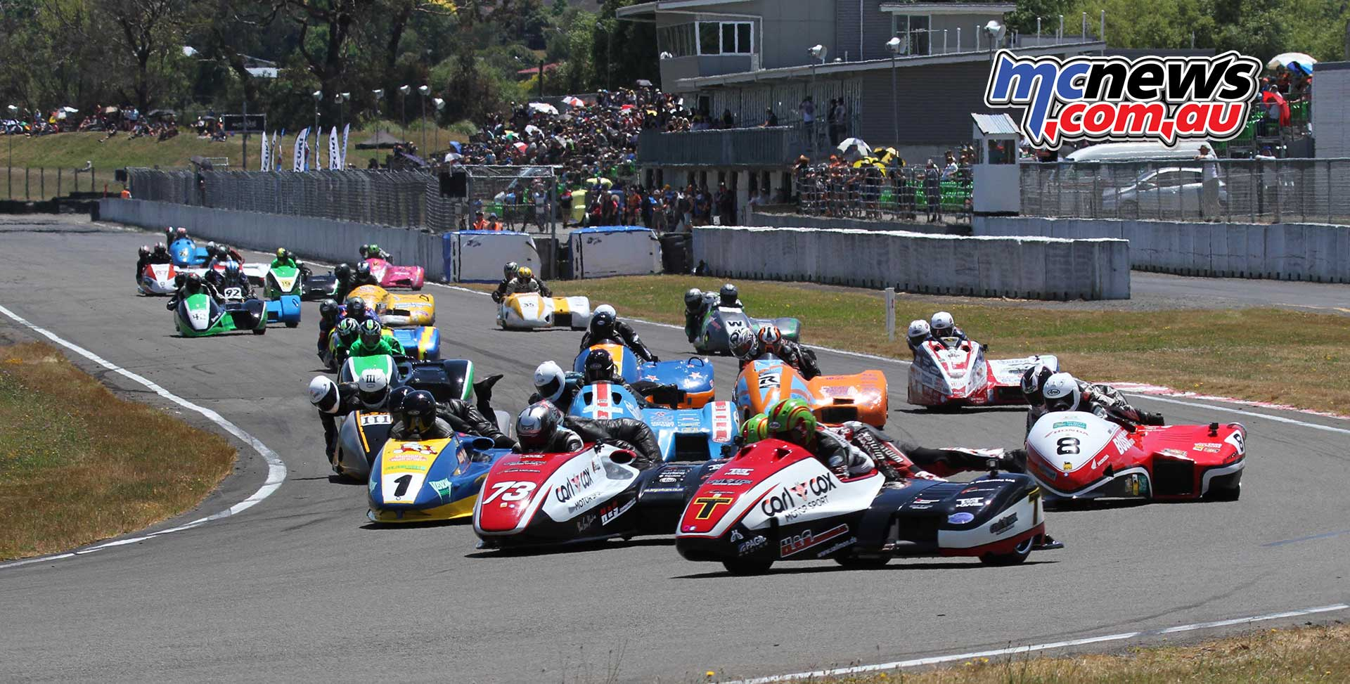Tim Reeves leads a crowded sidecar field into turn one at Manfeild on Sunday