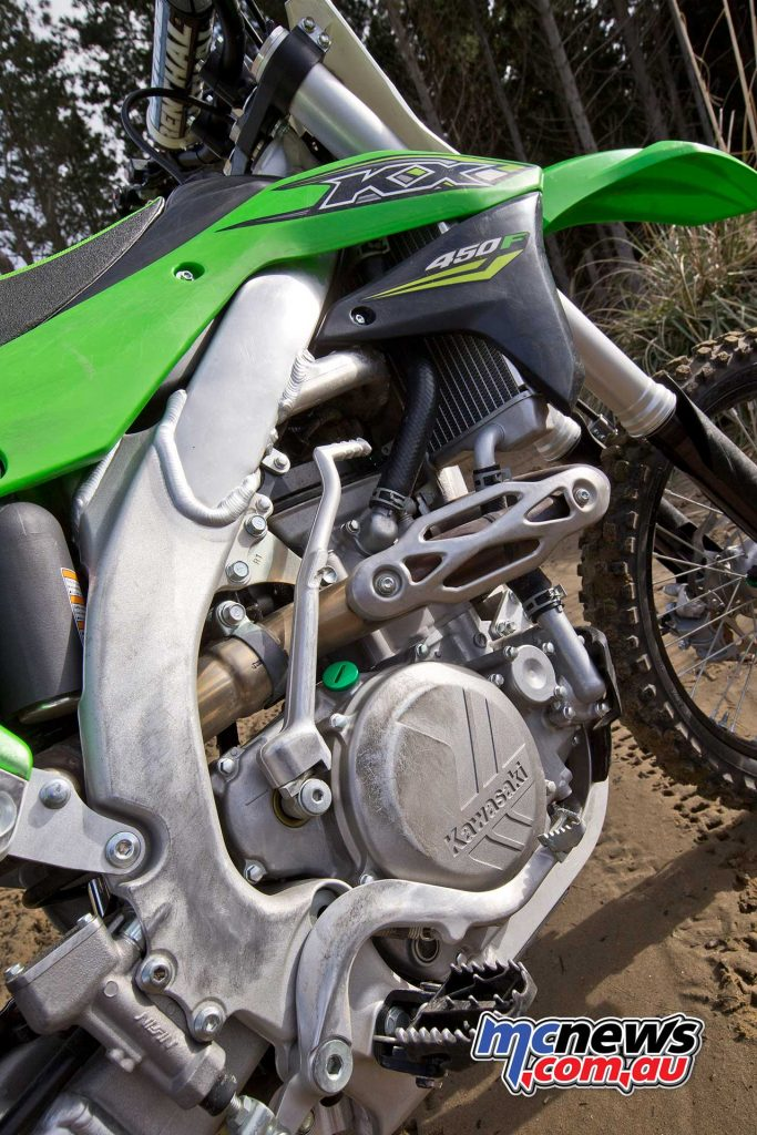 The 2018 KX450F features a 449cc liquid-cooled DOHC four-valve four-stroke single-cylinder with three engine fuel maps thanks to map plugs
