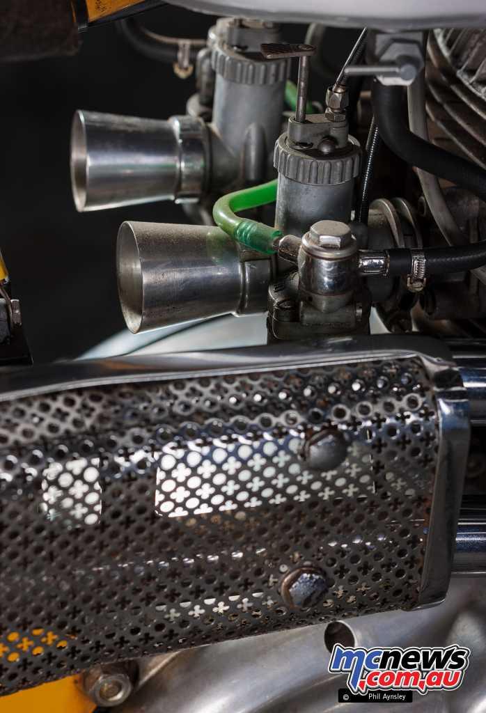 The carbs behind the exhaust sheild