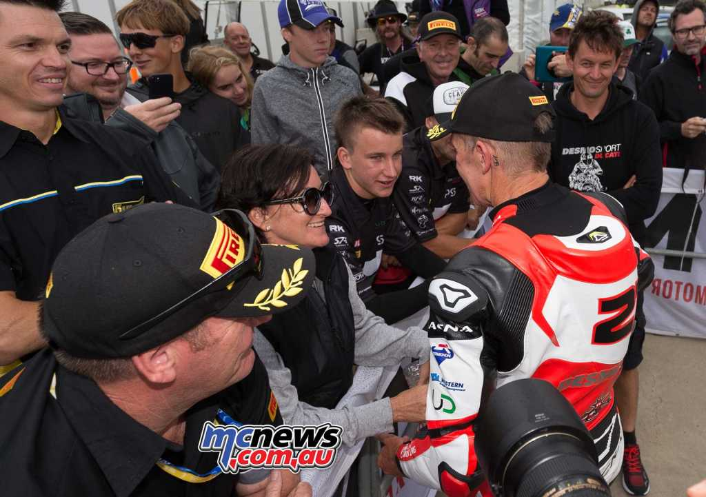 Troy Bayliss greeted by wife Kim and son Oli in Parc Ferme at the 2018 Phillip Island season opener - TBG Image