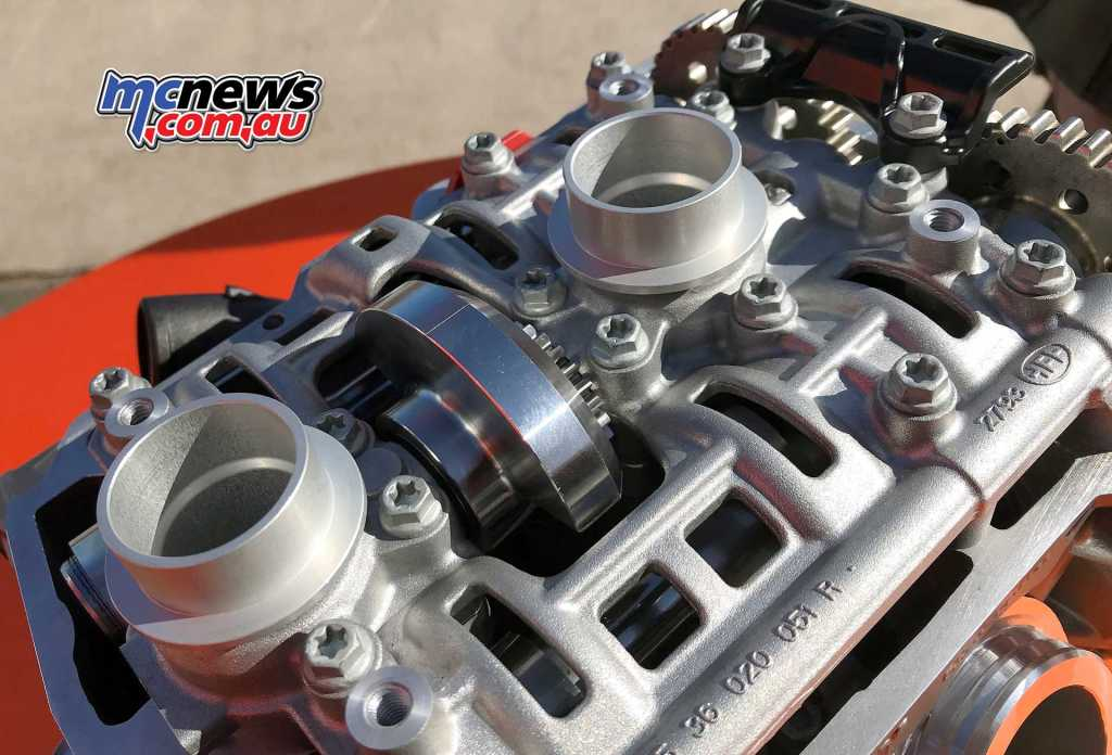 KTM 790 Duke cylinder head - The round ports are for the spark plugs to pass through, while the slotted covers seen here hide the camshafts. Between the two spark plug portals can be seen the chain driven counter balancer