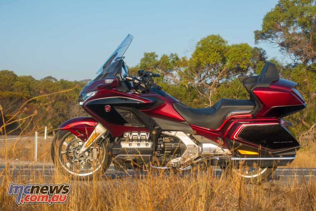 The new Gold Wing strikes a much more handsome pose than its predecessor with much smoother lines and a beautiful paint finish I reckon it is actually a very handsome machine
