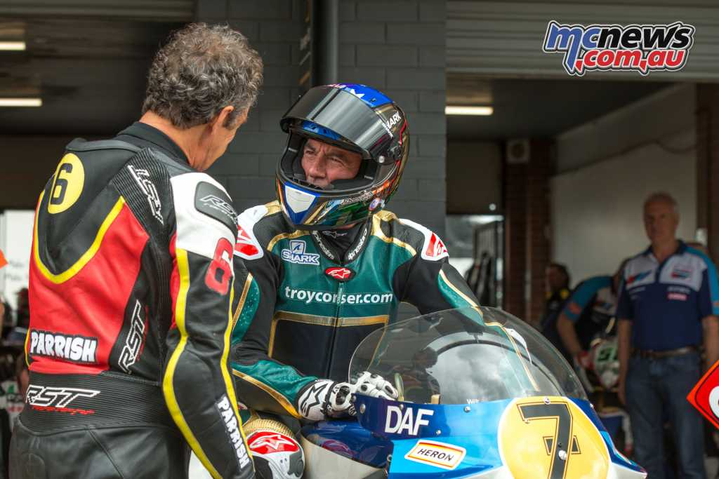 """Steve """"Stavros"""" Parrish (L) and Troy Corser discussing the attributes of the Suzuki RGB500 TC is sitting on. A very similar bike to the one Stavros rode as a team mate to the late Barry Sheene."""